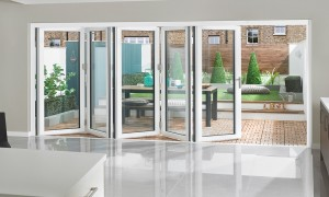 white aluminium bifolding door 5 part with seperate traffic door for easy access
